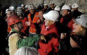 In this photo released by the Chilean presidential press office, Chile's President Sebastian Pinera, center right, greets the second rescued miner Mario Sepulveda after he was rescued from the collapsed San Jose gold and copper mine where he was trapped with 32 other miners for over two months near Copiapo, Chile, early Wednesday Oct. 13, 2010.  (AP Photo/Jose Manuel de la Maza, Chilean presidential press office)