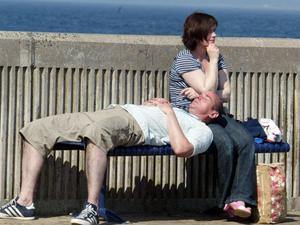 A couple relaxing  at The Cresent in Portstewart . June 2010