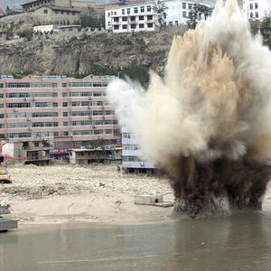 Sn explosion to blast away debris damming a river in Zhouqu County, China