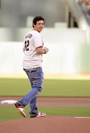 SAN FRANCISCO, CA - JUNE 12:  2011 US Open Golf Champion Rory McIlroy walks out to the mound to throw out the ceremonial  first pitch of a Major League Baseball game between the Houston Astros and San Francisco Giants at AT&T Park on June 12, 2012 in San Francisco, California.  (Photo by Thearon W. Henderson/Getty Images)