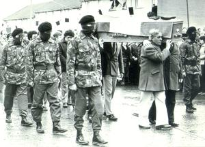 Hunger striker Bobby Sands coffin, flanked by an IRA colour party, leaving his mother's home in Twinbrook.