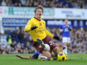 Everton's Phil Jagielka and Arsenal's Andrey Arshavin (front) battle for the ball during the Barclays Premier League match at Goodison Park, Liverpool. PRESS ASSOCIATION Photo. Picture date: Sunday November 14, 2010. See PA Story SOCCER Everton. Photo credit should read: Martin Rickett/PA Wire. RESTRICTIONS: Use subject to restrictions. Editorial print use only except with prior written approval. New media use requires licence from Football DataCo Ltd. Call +44 (0)1158 447447 or see www.pressassociation.com/images/restrictions for full restrictions.
