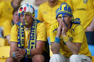 KIEV, UKRAINE - JUNE 15:  Sweden fans sit dejected at the final whistle during the UEFA EURO 2012 group D match between Sweden and England at The Olympic Stadium on June 15, 2012 in Kiev, Ukraine.  (Photo by Scott Heavey/Getty Images)