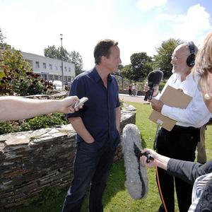 Prime Minister David Cameron speaks to the media outside the maternity ward of the Royal Cornwall Hospital in Truro