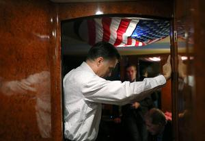 AVON LAKE, OH - OCTOBER 29:  Republican presidential candidate, former Massachusetts Gov. Mitt Romney listens in on conference call with advisors aboard his campaign bus en route to a campaign rally at Avon Lake High School on October 29, 2012 in Avon Lake, Ohio. Romney has canceled other campaign events on October 29 and 30 due to Hurrcane Sandy.  (Photo by Justin Sullivan/Getty Images) *** BESTPIX ***