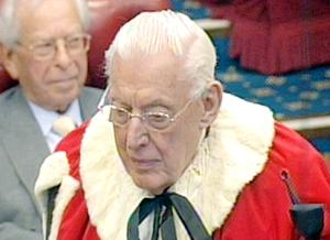 Ian Paisley in his ermine-trimmed red gown yesterday as he is sworn in