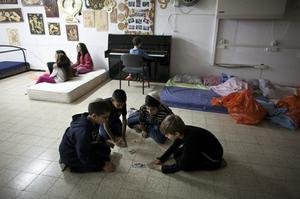 NETIVOT, ISRAEL - NOVEMBER 14:  (ISRAEL OUT) Israeli children play games at a bomb shelter on November 14, 2012 in Netivot, Israel. Israel Defense Forces launched aerial attacks on targets in Gaza that killed the top military commander of Hamas, (Photo by Uriel Sinai/Getty Images)
