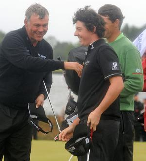 Darren Clarke, Padraig Harrington and Rory McIlroy at the 18th hole at the Lough Erne Golf Challenge