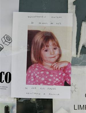 """A missing person poster is displayed showing 3-year old British girl Madeleine McCann, stuck to a board at a bus stop near the resort from where she went missing, Friday, May 4 2007, in Praia da Luz, southern Portugal. Portuguese police searched Friday for the 3-year-old British girl who went missing late Thursday from the upmarket resort in southern Portugal where she was on vacation with her family. Writing says """"Disappeared yesterday, if you see her contact the police""""."""