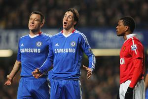 LONDON, ENGLAND - MARCH 01: Fernando Torres and John Terry (L) of Chelsea make their point with Patrice Evra of Manchester United during the Barclays Premier League match between Chelsea and Manchester United at Stamford Bridge on March 1, 2011 in London, England.  (Photo by Clive Rose/Getty Images)
