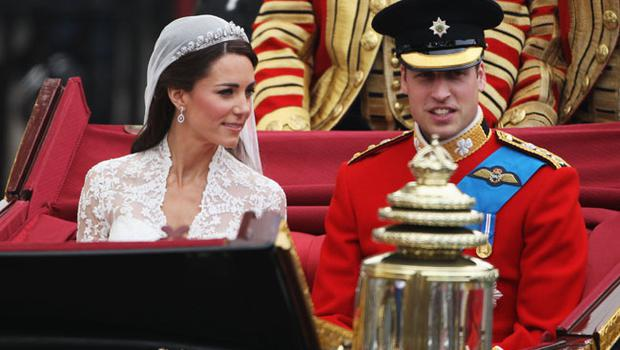 LONDON, ENGLAND - APRIL 29:  Their Royal Highnesses Prince William Duke of Cambridge and Catherine Duchess of Cambridge make the journey by carriage procession to Buckingham Palace following their marriage at Westminster Abbey on April 29, 2011 in London, England. The marriage of the second in line to the British throne was led by the Archbishop of Canterbury and was attended by 1900 guests, including foreign Royal family members and heads of state. Thousands of well-wishers from around the world have also flocked to London to witness the spectacle and pageantry of the Royal Wedding.  (Photo by Dan Kitwood/Getty Images)