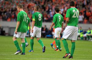 Northern Ireland take the walk back to the centre circle