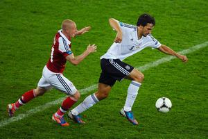 L'VIV, UKRAINE - JUNE 17:  Mats Hummels of Germany is put under pressure by Niki Zimling of Denmark during the UEFA EURO 2012 group B match between Denmark and Germany at Arena Lviv on June 17, 2012 in L'viv, Ukraine.  (Photo by Laurence Griffiths/Getty Images)