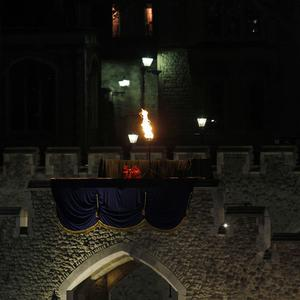 A beacon is lit on the battlements of the Tower of London (AP/Sang Tan)