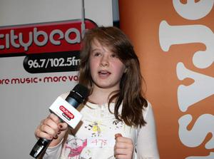 Lucy Brown from South Belfast on stage at the City Beat Young Star search auditions