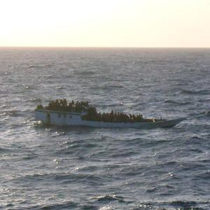 A boat carries asylum seekers north of Christmas Island in the Indian Ocean hours before capsizing (AP/Australian Maritime Safety Authority)