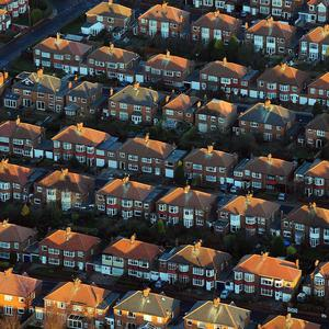 Nelson McCausland said planned restructuring afforded the opportunity to build more houses and improve quality