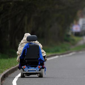 An 80-year-old woman suffered a broken arm after she was knocked to the ground by a mobility scooter