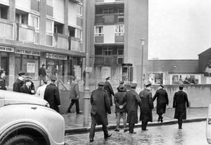 Riots : Belfast. August 1969.  Police move in after milk bottles were thrown from the flats at Unity Place, Peters Hill, Belfast at a crowd of people on the Shankill Road waiting for the Junior Orangemen to march past.  (2/8/69)