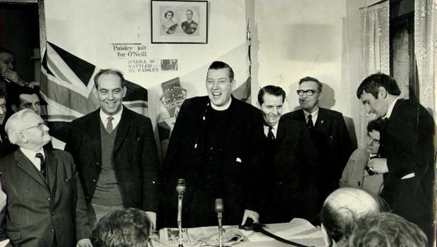 Ian Paisley:Democratic Unionist Party (DUP),ENJOYS A JOKE WITH MAJOR RONALD BUNTING DURING A PRESS CONFERENCE AT ELECTION HEADQUARTERS IN BELFAST. ON THE LEFT IS COUNCILLOR WILLIAM SPENCE. 27/2/1969