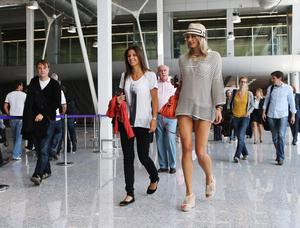 L'VIV, UKRAINE - JUNE 09:  Lena Gercke (R), girlfriend of Sami Khedira and Silvia Meichel, girlfriend of Mario Gomez are seen at the airport  Lviv on June 9, 2012 in L'viv, Ukraine.  (Photo by Joern Pollex/Getty Images)