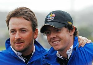 Rory McIlroy of Europe and Graeme McDowell (L) support their team mates during the  Fourball & Foursome Matches during the 2010 Ryder Cup at the Celtic Manor Resort on October 3, 2010 in Newport, Wales