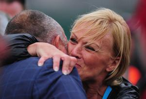 SANDWICH, ENGLAND - JULY 17:  Manager Andrew 'Chubby' Chandler embraces Darren Clarke's girlfriend Alison Campbell at the end of the final round of The 140th Open Championship at Royal St George's on July 17, 2011 in Sandwich, England.  (Photo by Stuart Franklin/Getty Images)