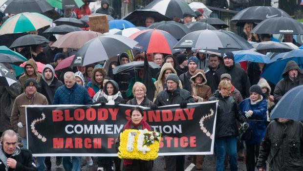 Linda Nash carries flowers with the number 14 inscribed during yesterdays annual Bloody Sunday Parade in Derry. Picture Martin McKeown. Inpresspics.com. 29.1.12