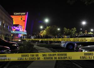 People gather outside the Century 16 movie theatre in Aurora, Colo., at the scene of a mass shooting early Friday morning, July 20, 2012.