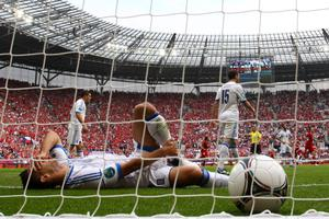 WROCLAW, POLAND - JUNE 12:  Kostas Katsouranis of Greece lies in the goal after Vaclav Pilar of Czech Republic scored their second goal during the UEFA EURO 2012 group A match between Greece and Czech Republic at The Municipal Stadium on June 12, 2012 in Wroclaw, Poland.  (Photo by Christof Koepsel/Getty Images)