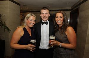 Stuart Dallas was awarded the Carling Young Player of the Year. Pictured with him is Jordana Grimes and Denise Catney  from Carling