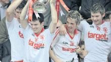 At the double: Shea McGarrity lifts the Cup after Tyrone Minors defeated Armagh in the Ulster Minor final at Clones.