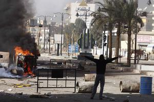 A protestor is seen in the streets during protests in Suez, Egypt, Friday, Jan. 28, 2011. Tens of thousands of anti-government protesters poured into the streets of Egypt Friday, stoning and confronting police who fired back with rubber bullets and tear gas in the most violent and chaotic scenes yet in the challenge to President Hosni Mubarak's 30-year rule.