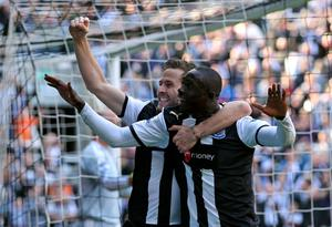 NEWCASTLE UPON TYNE, ENGLAND - APRIL 01:  Papiss Cisse of Newcastle United celebrates scoring the opening goal with team mate Yohan Cabaye (L) during the Barclays Premier League match between Newcastle United and Liverpool at Sports Direct Arena on April 1, 2012 in Newcastle upon Tyne, England.  (Photo by Alex Livesey/Getty Images)