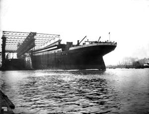 The Titanic launches into the water. Photograph © National Museums Northern Ireland. Collection Harland & Wolff, Ulster Folk & Transport Museum