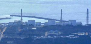 No. 3 unit of the Fukushima Daiichi Nuclear Power Plant, is seen, 2nd from right, with unit 1 reactor, left, with its top part of walls blown off after Saturday's explosion seen in Okumamachi, Fukushima Prefecture (state) , northern Japan Monday, March 14, 2011. Japanese officials say they believe a hydrogen explosion has occurred at the nuclear plant, similar to an earlier one at a different unit in the facility. (AP Photo/Kyodo News)  JAPAN OUT, MANDATORY CREDIT, NO SALES IN CHINA, HONG  KONG, JAPAN, SOUTH KOREA AND FRANCE