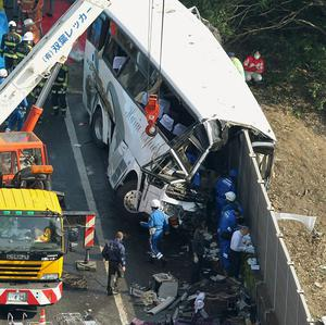 The wreckage of a destroyed bus in Fujioka, Gunma prefecture, north of Tokyo (AP/Kyodo News)