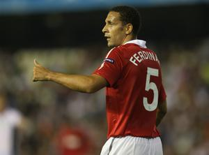 Rio Ferdinand of Manchester United gives a thumbs up during the UEFA Champions League Group C match between Valencia and Manchester United at the Mestalla Stadium on September 29, 2010 in Valencia, Spain