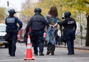 PORTLAND - NOVEMBER 13: A young protester is led off to jail in handcuffs after being arrested near the Occupy Portland encampment November 13, 2011 in Portland, Oregon. Portland police have reclaimed the two parks in which occupiers have been camping after a night of brinksmanship with protesting crowds of several thousands. (Photo by Natalie Behring/Getty Images)