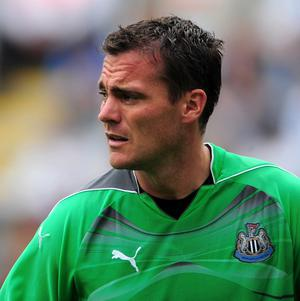 A football fan who ran on to a pitch and floored goalkeeper Steve Harper has been banned from Sunderland and England matches
