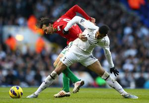 LONDON, ENGLAND - DECEMBER 16:  Michu of Swansea City and Sandro of Tottenham Hotspur battle for the ball during the Barclays Premier League match between Tottenham Hotspur and Swansea City at White Hart Lane on December 16, 2012 in London, England.  (Photo by Paul Gilham/Getty Images)