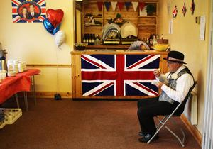 YARDLEY HASTINGS,  UNITED KINGDOM - APRIL 29 : Brian Abbott, 77, eats his breakfast in the village hall as they prepare to celebrate the marriage of Prince William to Catherine Middleton on April 29, 2011 in  Northamptonshire, United Kingdom.  The marriage of Prince William, the second in line to the British throne, to Catherine Middleton is being held in London today. The Archbishop of Canterbury conducted the service which was attended by 1900 guests, including foreign Royal family members and heads of state. Thousands of well-wishers from around the world have also flocked to London to witness the spectacle and pageantry of the Royal Wedding and street parties are being held throughout the UK.  (Photo by Mark Thompson/Getty Images)