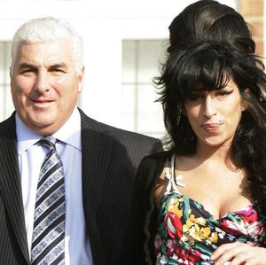 Mitch Winehouse says he has spoen to his daughter Amy through a psychic