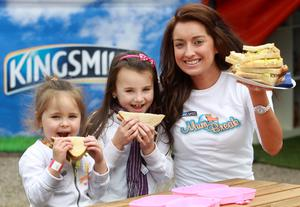 Sisters Lucy and Lauren Reel are pictured enjoying a sandwich with Caroline Reid at the Kingsmill 'Mum Break' tent at Balmoral Show. Housed in a giant loaf, the Kingsmill 'Mum Break' offers mums who visit Balmoral a relaxing pit stop in the midst of the busy day out.