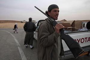 Libyan anti-government fighters man a checkpoint in the outskirts of the southwestern town of Nalut, Libya,  Monday, Feb. 28, 2011. (AP Photo/Lefteris Pitarakis)
