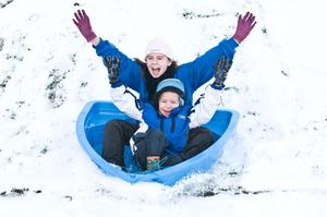 Shannon and Joshua Willoc play in the snow in St. Columb's Park, Derry