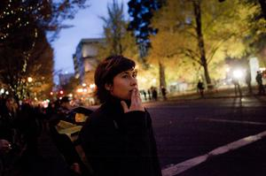 PORTLAND - NOVEMBER 13: A woman reacts as the Occupy Wall Street protests continue November 13, 2011 in Portland, Oregon. Portland police have reclaimed the two parks in which occupiers have been camping after a night of brinksmanship with protesting crowds of several thousands. (Photo by Natalie Behring/Getty Images)