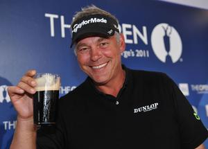 SANDWICH, ENGLAND - JULY 17:  Darren Clarke of Northern Ireland toasts his victory with a pint of Guinness at the end of the final round of The 140th Open Championship at Royal St George's on July 17, 2011 in Sandwich, England.  (Photo by Stuart Franklin/Getty Images)