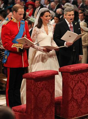 LONDON, ENGLAND - APRIL 29: Prince William sings beside his bride Catherine Middleton and her father Michael Middleton on April 29, 2011 in London, England.  The marriage of Prince William, the second in line to the British throne, to Catherine Middleton is being held in London today. The marriage of the second in line to the British throne is to be led by the Archbishop of Canterbury and will be attended by 1900 guests, including foreign Royal family members and heads of state. Thousands of well-wishers from around the world have also flocked to London to witness the spectacle and pageantry of the Royal Wedding.  (Photo by Dominic Lipinski - WPA Pool/Getty Images)