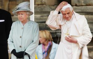 Pope Benedict XVI replaces his zucchetto as he meets with Queen Elizabeth II at the Palace of Holyroodhouse in Edinburgh on the first day of his four day visit to the United Kingdom